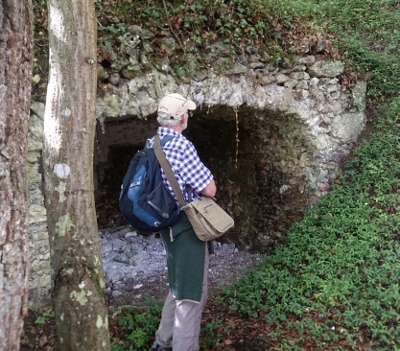 Thame Twinning member David Laver,  by a derelect grotto once luxuriously fitted out for a duchess and her guests to rest