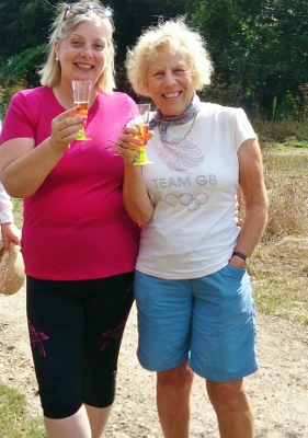 Linda Emery and Cynthia Jackson enjoy a glass of cider during the picnic break on the last day of their 3 day walk